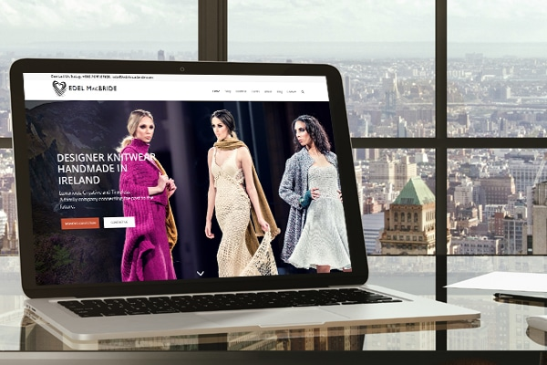 image of Edel's fashion knitwear viewed on her website on a laptop