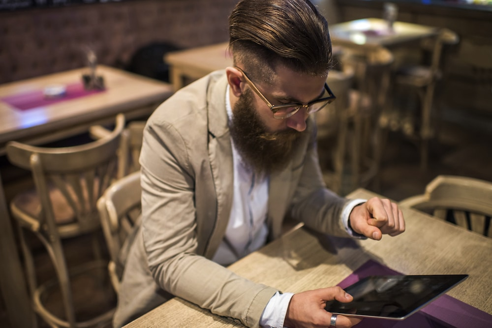 Image of a man finding a website on his iPad using SEO search engine optimisation