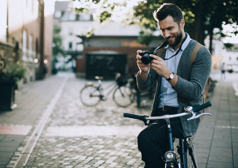 Image of a man on a bike looking at a web design on his mobile device in Northern Ireland